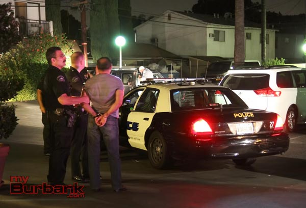Burbank Police take a suspect into custody following a felony stop of a reported stolen SUV. (Photo by Ross A. Benson)