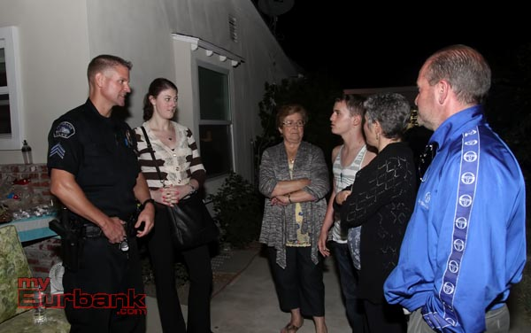 Burbank Police Sergent John Prommer and Crime Analyst Jessica Statland talk to a group of residents in the 1000 Blk of West Orange Grove (Photo by Ross A. Benson)