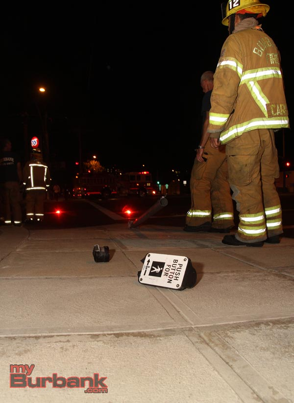 Crosswalk signal button was knocked down during accident. (Photo by Ross A. Benson)