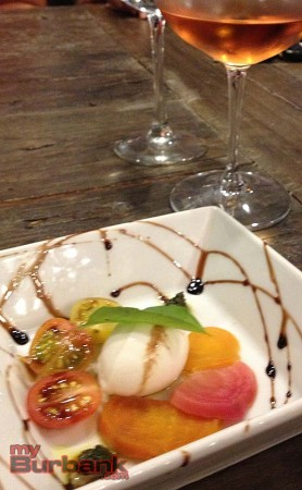 Mozzarella, beet and tomato salad with a Sonoma Coast Rose. (Photo by Lisa Paredes)