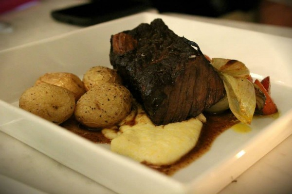 Braised short rib and root vegetables with cheesy polenta. (Photo Courtesy of Ashley Erikson)
