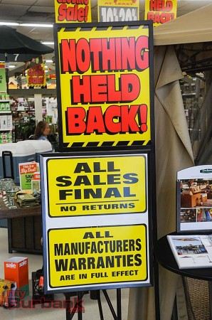 Signs inside OSH encourage final sales (Photo By Craig Sherwood)