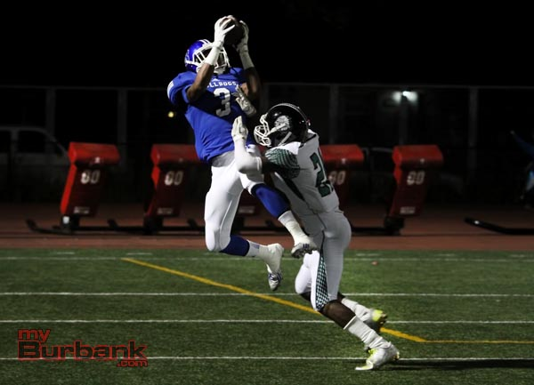 Oharjee Brown snatches a pass high above a defender (Photo by Ross A. Benson)