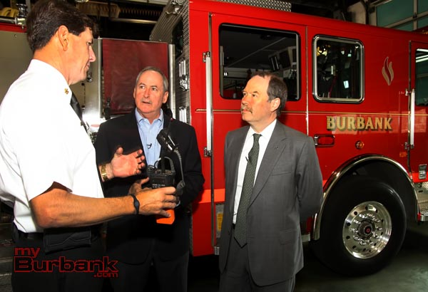 Burbank Fire Chief Tom Lenahan demonstrates how the donation will be used for new VHF radios. (Photo by Ross A. Benson)
