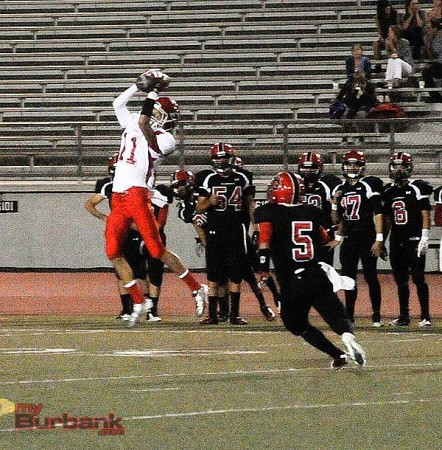 Eric Hernandez makes a nice grab for Burroughs (Photo by Craig Sherwood)