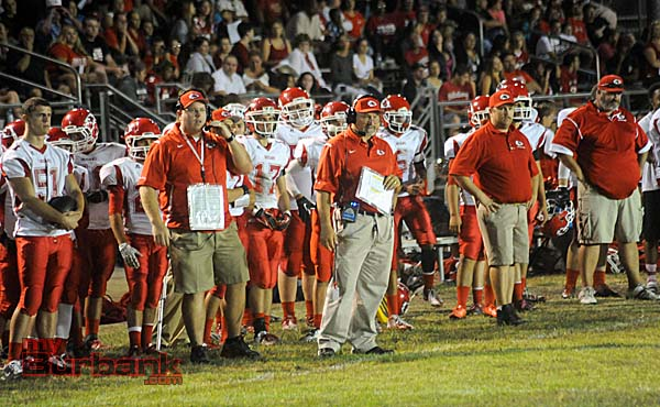 Hawkins Mann (left, #51) watches alongside his new teammates and coaches (Photo by Craig Sherwood)