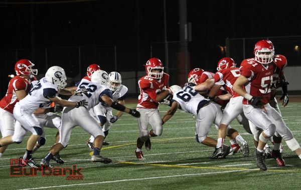 Michael Ospina finds  a hole in the Camarillo defense (Photo by Ross A. Benson)