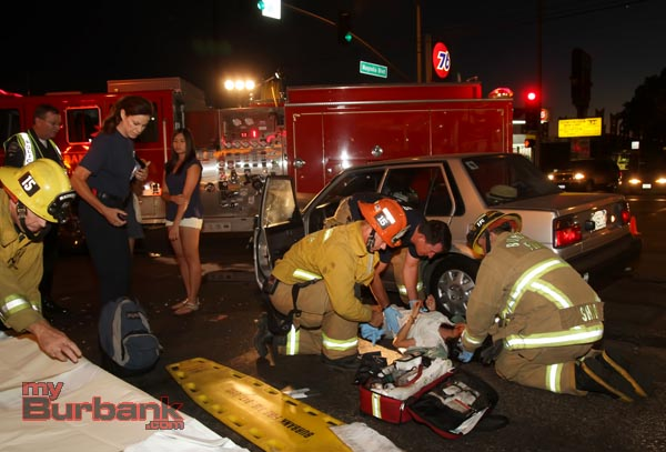 Burbank paramedics treat the passenger of one of the cars involved prior to transporting her to Providence Holy Cross. (Photo by Ross A. Benson)