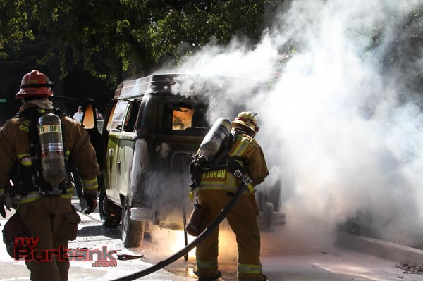 Burbank Firefighters work to extinguish this VW Van fire. (Photo by Ross A. Benson)