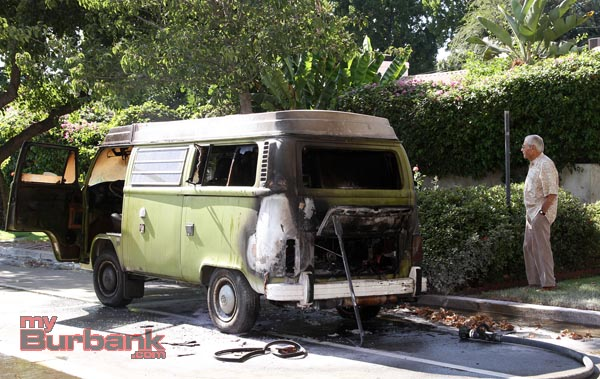 Ed Ricksecker van owner looks at what's left of his 77 VW Van Popup. (Photo by Ross A. Benson)