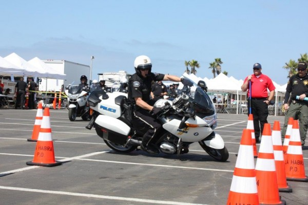 Officer Ryan Murphy tilts the heavy bike deeply to get through the patterns. (Photo Courtesy of Burbank Police Dept.)