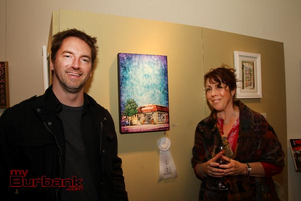 "Mark Brunner with mixed media ""Mindfulnest"" and Mindfulnest co-owner Amanda Vernon."