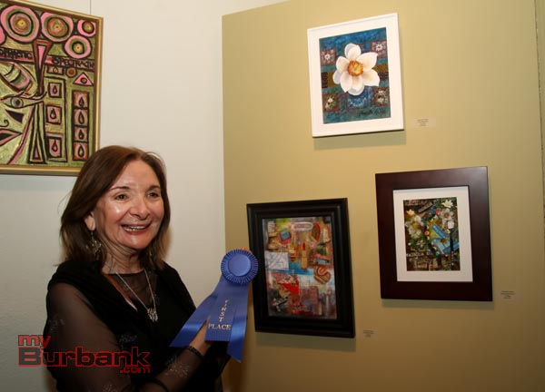 "Harriette Kahn and first place ""Shopping Spree,"" a collage. (Photo By Ross A. Benson)"