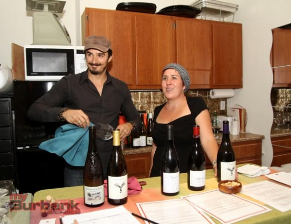 Nick Caballero and Shannon VerGow pour for Luna Vine Wine Bar. (Photo By Ross A. Benson)