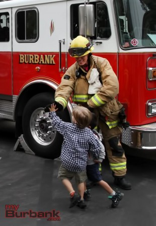 High-fives with Burbank firefighters were a favorite part of the morning. (Photo By Ross A. Benson)