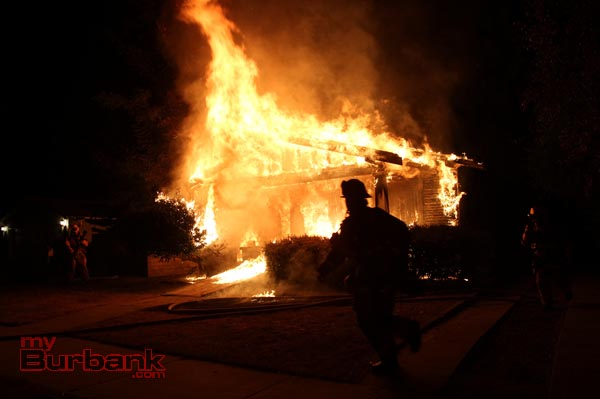 Burbank Firefighters prepare to extinguish the flames that consumed to front of the house at 910 N. Evergreen Street Saturday evening. (© 2013 Ross A. Benson)