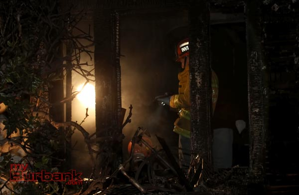 Fire Investigators from Burbank and Pasadena look for the cause of the fire at 910 Evergreen Street. (Photo by Ross A. Benson)