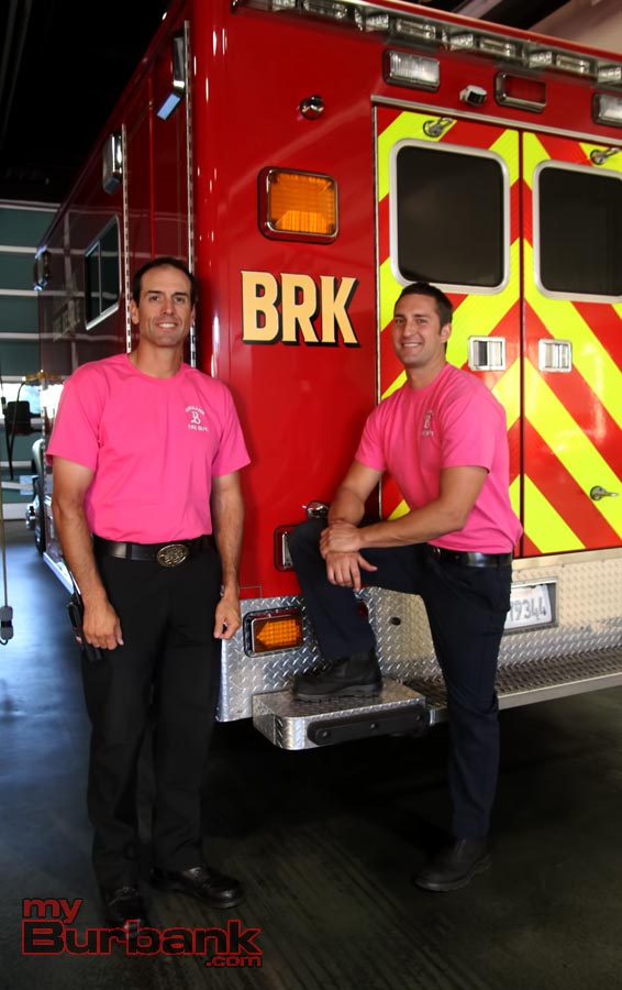 Battalion Chief Eric Garcia and Fire Firefighter Nick Rosche model the Breast Cancer Awareness Tee Shirts.(Photo by Ross A. Benson)