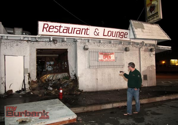 Burbank City Councilman Gary Bric surveys the damage to his restaurant following a crash of a stolen BMW. (Photo by Ross A. Benson)
