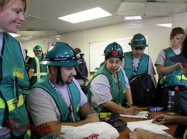 Burbank's CERT Team members listen to Magda Sellon give instructions prior to going into the competition.(Photo by Ross A. Benson)