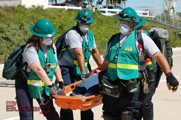 Burbank's CERT team carries a victim to a safe area. (Photo Courtesy of Chester Brown)