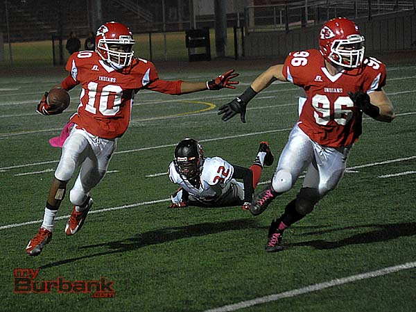 Eric Gordon returns a punt for a touchdown with Hawkins Mann leading the way (Photo by Craig Sherwood)