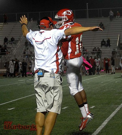 Eric Gordon chest bumps Coach Kenny Knoop after Gordon's strip and score (Photo by Craig Sherwood)