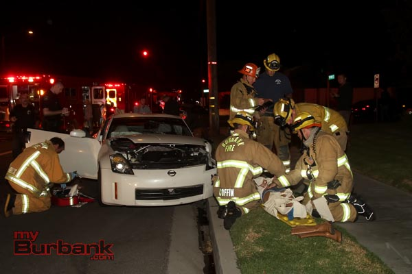 Burbank Fire Fighters assist Paramedics in patient care after this accident happened late Wednesday evening at Pass & Verdugo Avenues. (Photo b y Ross A. Benson)
