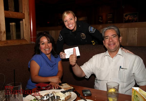 Burbank City Councilmen Bob Frutos with his wife Laura supported 'Tip A Cop' Frutos himself a Police Officer for LAPD, is a large supporter of Special Olympics. ( Photo by Ross A. Benson)