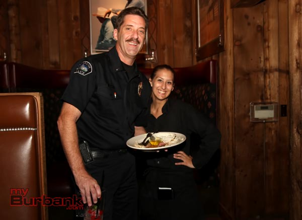 Burbank Police Lt. John Dilbert was caught busing tables during the event. ( Photo by Ross A. Benson)