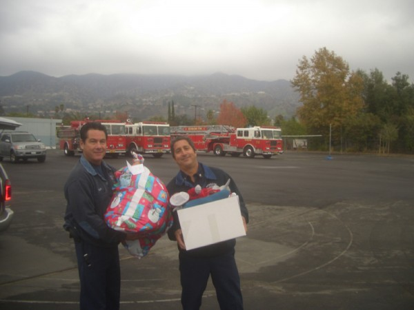Firefighters prepare to deliver holiday packages. (Photo Courtesy of Burbank Coordinating Council)