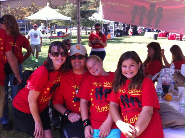 Rebecca, Jon, Olivia (age 12) and Rachel (age 10) Huntley pose together at the ALS Walk. (Photo Courtesy of the Huntley Family.)