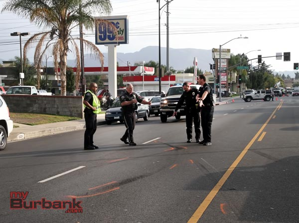 Burbank Traffic Officers piece together accident site following accident involving a Burbank Police car responding to a 'Field Emergency' Monday afternoon.(Photo by Ross A. Benson)