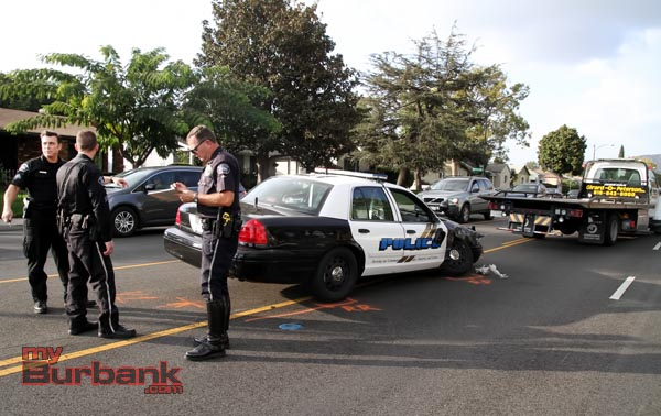 Burbank Traffic Officers take notes and measures following accident involving a Burbank Police cruiser Monday afternoon. (Photo by Ross A. Benson)