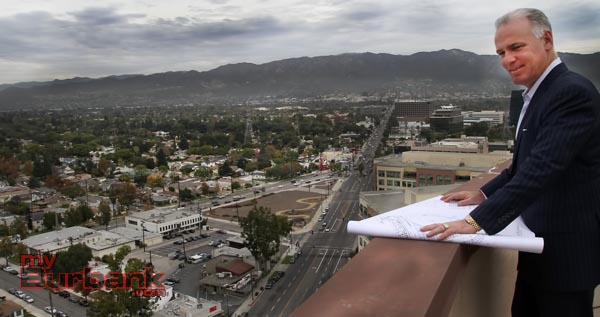 Michael Cusumano looks at plans for Talaria at Burbank above the proposed development site. (Photo By Ross A. Benson)