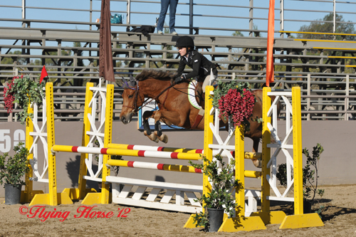 Faith Cunningham soars to victory in the West Coast Pony Jumper Finals with Miss Marple. (Photo Courtesy of Flying Horse Photography)