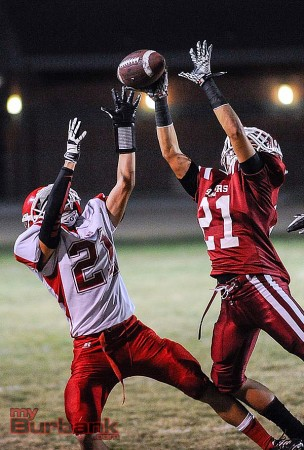 Blackjack anyone? Burroughs' Aidan Anding (lt) goes up for a pass (Photo by Craig Sherwood)
