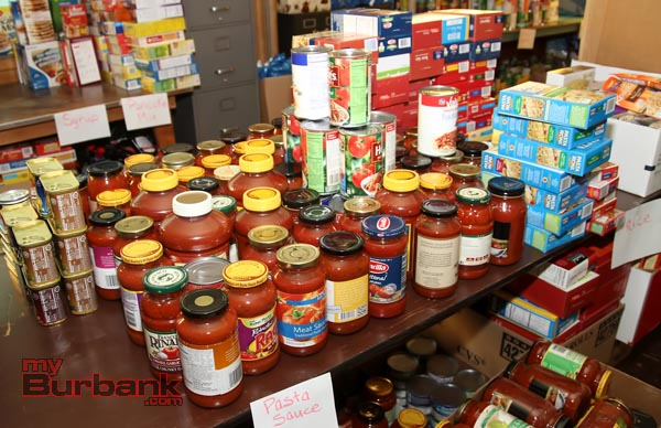 Some of the food collected at the 2013 food drive. Volunteers are needed for the 2014 Holiday Baskets donation drive which kicks off Saturday, October 11, in Burbank. (Photo By Ross A. Benson)