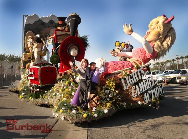 """Burbank Mayor Emily Gabel-Luddy and Director Gary Marshall sit on this years Rose Parade """"Lights Camera Action"""" that will roll down this years 125th Rose Parade. Gary's son Scott Marshall sits running the camera behind.(Photo by Ross A. Benson)"""