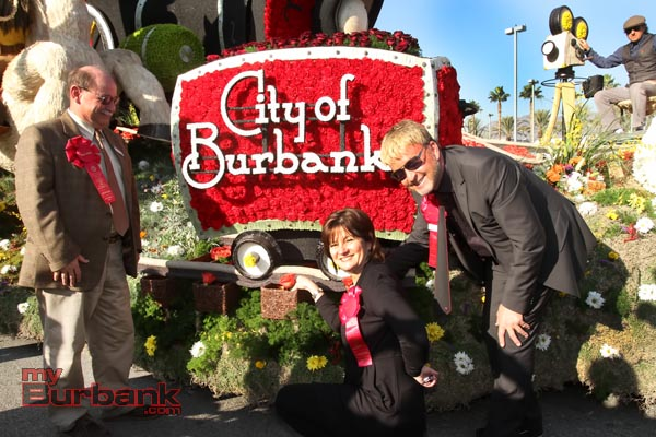 Rose Parade judges  James Folsom, Cheryl Cecchetto and Rene Van Rems puts the last roses on this years Burbank Float after it's final judging Tuesday afternoon.(Photo by Ross A. Benson)