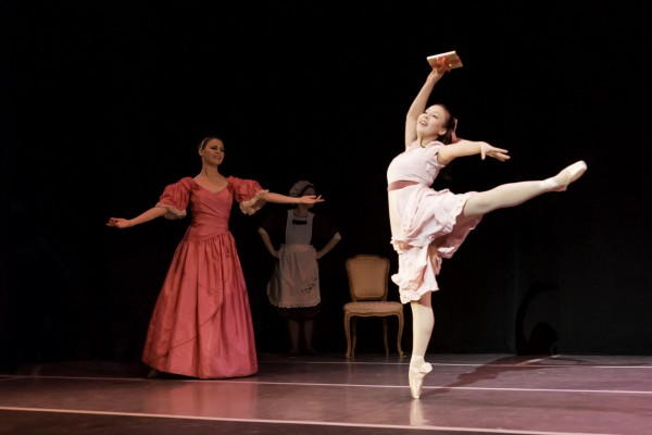 Clara (Alexandria Wong) dances for joy at her present as her mother (Elissa Brock) looks on.  (Photo Courtesy of Tom Pease)