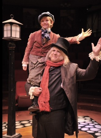 "Jaymes Hale plays Tiny Tim and Daniel Roebuck is Ebenezer Scrooge in Glendale Centre Theatre's ""A Christmas Carol"".   (Photo Courtesy of Dennis Stover)"