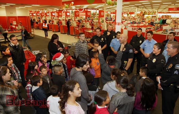 "Burbank Police Officers, Explorers, Cadets and Volunteers teamed up with Burbank Noon Rotary members at Target at the Empire Center Thursday evening and held this years""Heroes and Helpers"". The kids were given gift cards and went through the store picking gifts for family members. (Photo by Ross A. Benson)"