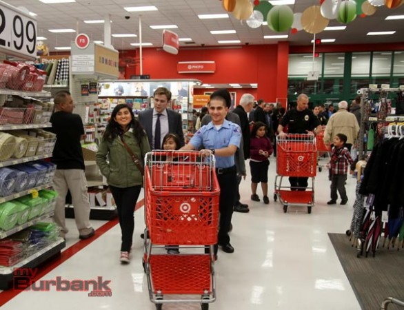"Burbank Police Officers, Explorers, Cadets and Volunteers teamed up with Burbank Noon Rotary members at Target at the Empire Center Thursday evening and held this years""Heroes and Helpers"". The kids were given gift cards and went through the store picking gifts for family members, with the help of Burbank's true Hero's. (Photo by Ross A. Benson)"