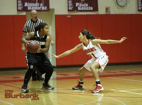 Burroughs' Justine Barraza defends a Golden Valley player (Photo by Ross A. Benson)