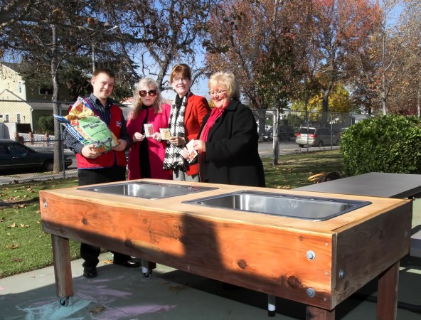 Lowe's Roby Beabout, Cartoon Network's Zita Lefebvre, Mayor Emily Gabel-Luddy and Stevenson Principal Debbie Ginnetti stand with the new moveable garden planter donated by Lowe's for disabled children at the school. (Photo By Ross A. Benson)