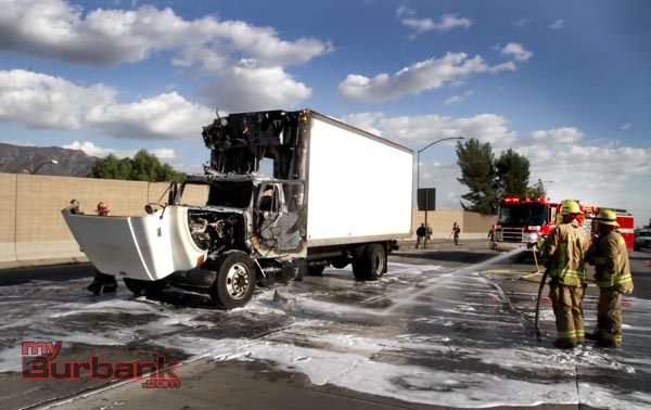 Burbank & Glendale Firefighters hose down cooking oil that leaked onto the freeway after the truck caught fire northbound I-5 at the Lincoln Street exit.(Photo by Ross A. Benson)