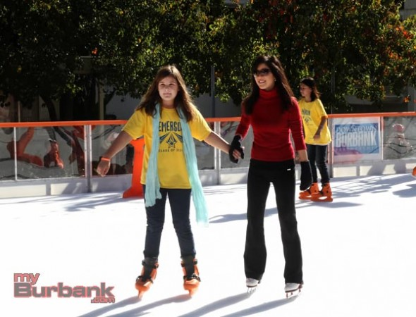 Olympian Kristi Yamaguchi lends a hand to Rachel Huntley  during her visit at  The Rink on Wednesday. (Photo by Ross A. Benson)