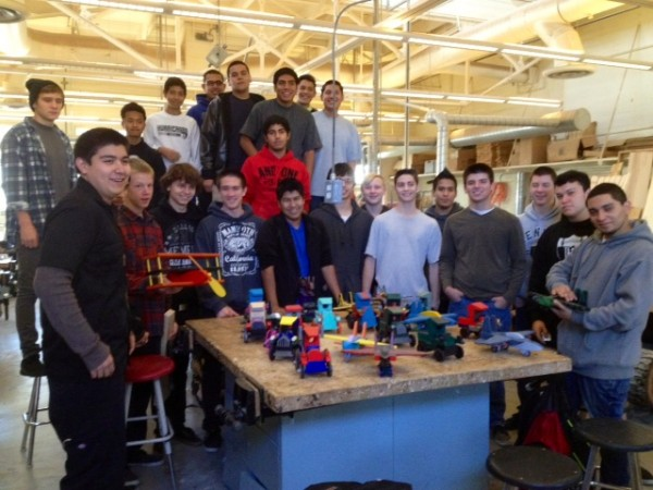 John Bene's advanced wood shop class build wooden cars, planes and animal shaped pull toys as a charity project