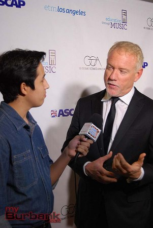 Composer John Debney speaks with a teen reporter on the red carpet. (Photo By Lisa Paredes)